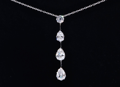 A diamond four stone drop pendant, 5.5ct total - Sold for €15,000
