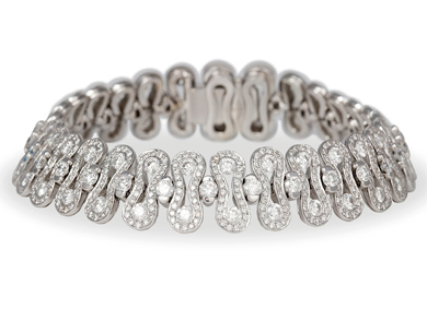 A diamond and fancy - link 'Wave' bracelet by Waskoll, Paris, 12.50ct total - Sold for €8,500